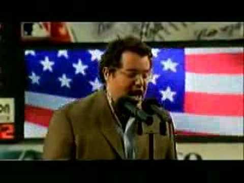 Reid Genauer singing The National Anthem at Shea Staduim