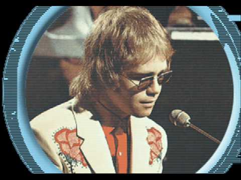 "Elvis Costello - ""She"" starring Elton John"