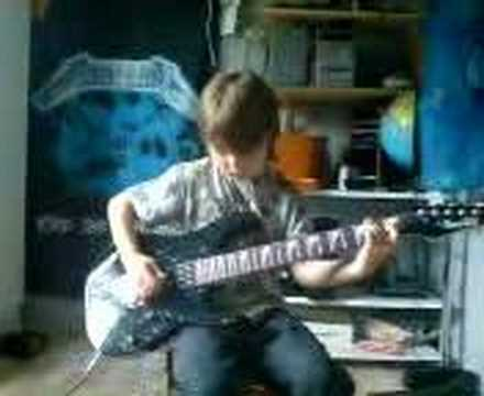 Eight year old plays metallica - one