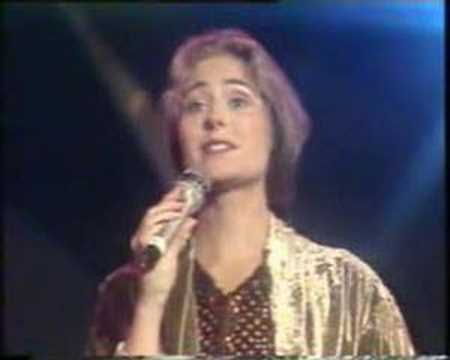 Sissel sings Solitaire with Neil Sedaka.