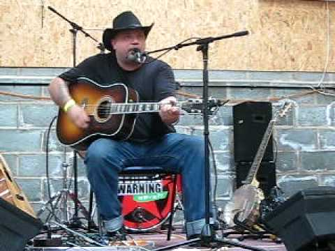 Rory Ellis - Waiting for the Armourguard Truck, Glastonwick 2010